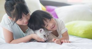 Girls cuddling with cat 300x162 - Girls-cuddling-with-cat